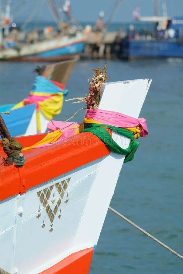Bow of wooden fishing boat royalty free stock photo