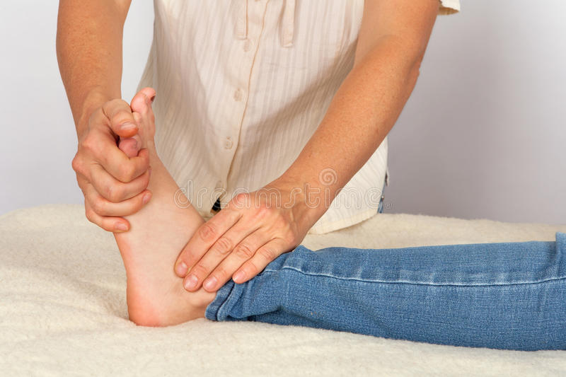 Bowen therapy - massage treatment. Of a foot stock photo