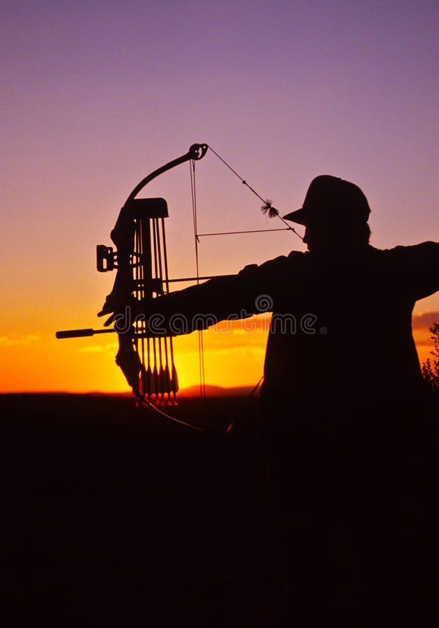 Download Bowhunter At Full Draw In Sunset Stock Photo - Image: 17304852