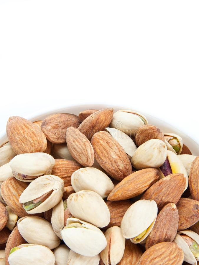 Bowl with almonds and pistachios royalty free stock photo
