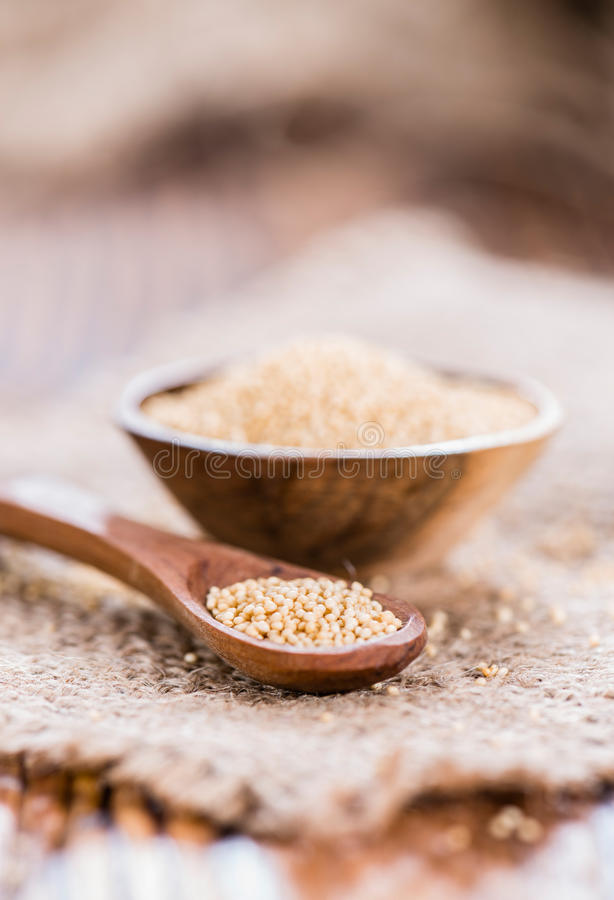 Bowl with Amaranth. On wooden background (close-up shot stock photo