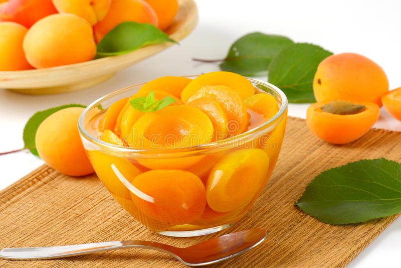 Bowl of apricot compote. Compote made of halved apricots in light syrup stock photography