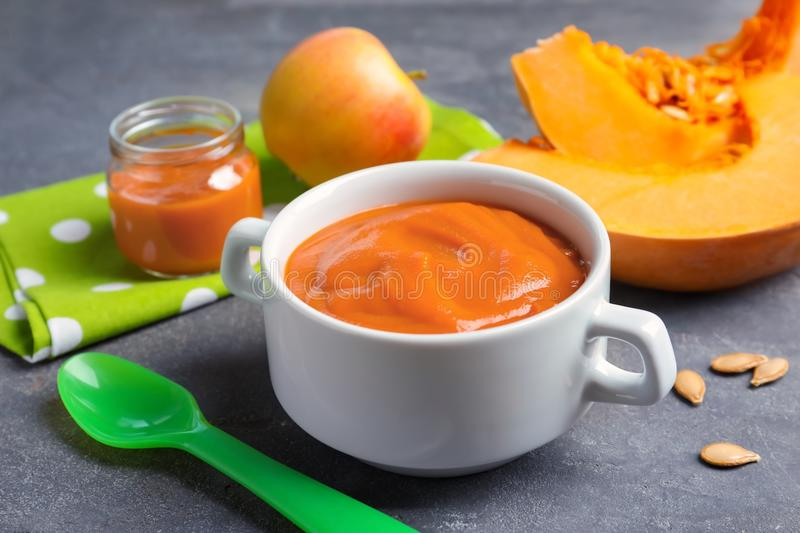 Bowl with baby food. On table royalty free stock images