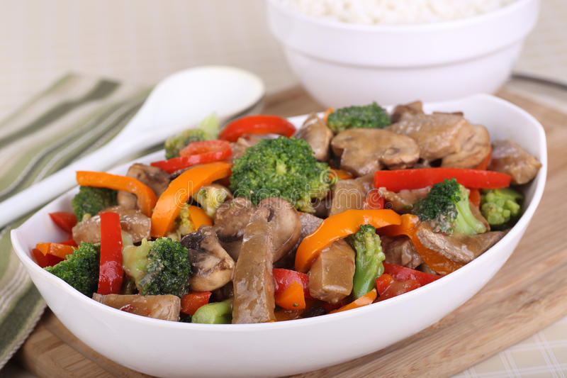 Bowl of Beef Stir Fry. Beef stir fry with broccoli; mushrooms and peppers in a bowl royalty free stock image
