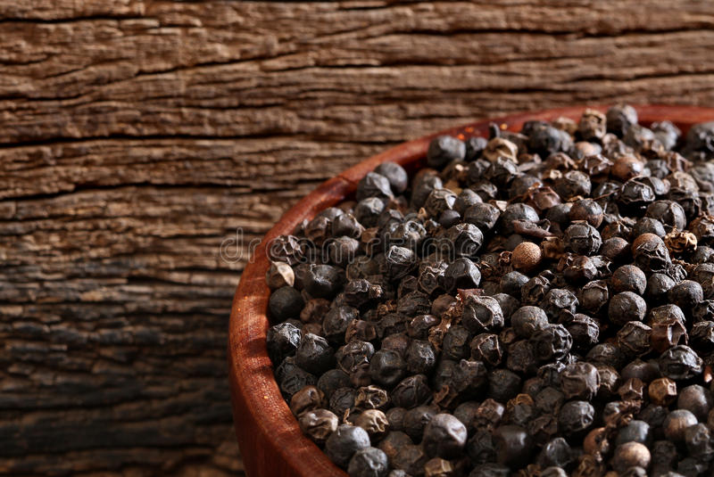 Download Bowl with black pepper stock photo. Image of texture - 27898436