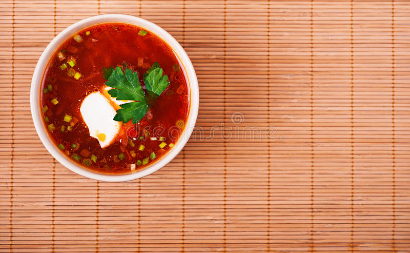 Download Bowl Of Borscht On Bamboo Table Stock Image - Image: 22220893