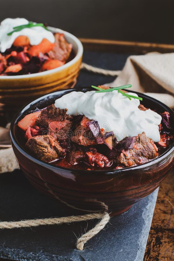 Bowl of Borscht Soup with Meaty Chunks of Beef and Sour Cream royalty free stock images