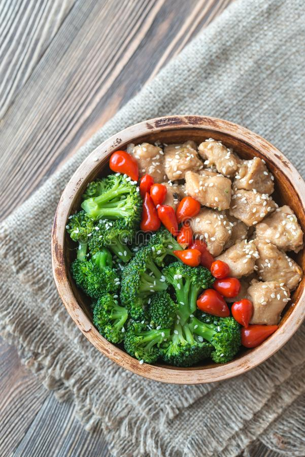 Bowl of broccoli and chicken stir-fry. Top view royalty free stock photo
