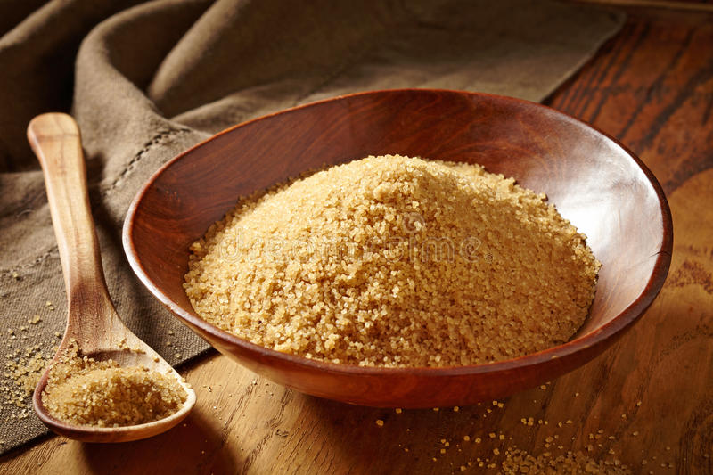 Bowl of brown sugar. And wooden spoon stock photography