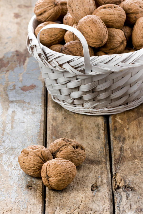 Bowl with Bunch of Walnuts stock images