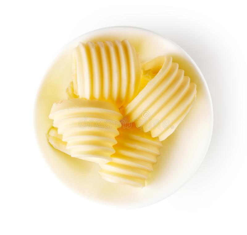 Butter curls isolated on white, from above stock photo