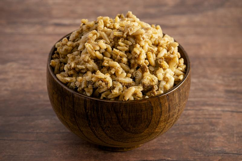 Bowl of Cajun Dirty Rice on a Rustic Wooden Table stock photos