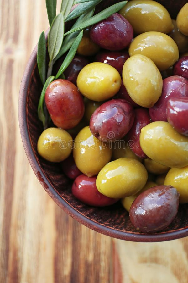 Bowl with canned olives stock photography