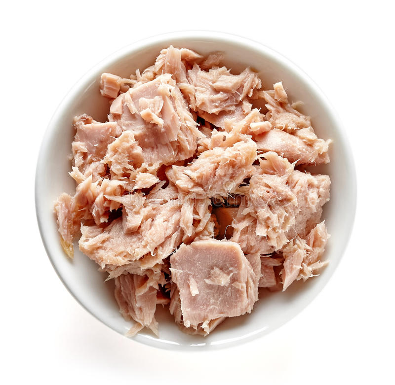 Bowl of canned tuna isolated on white, from above stock photos