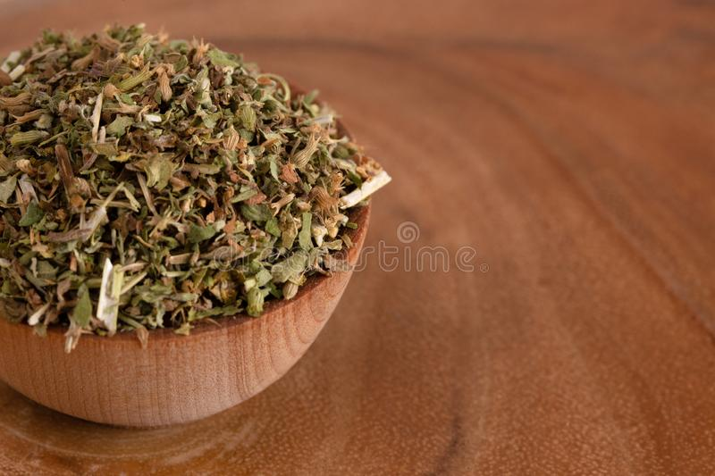 Bowl of Catnip on Wooden Table. A Bowl of Catnip on Wooden Table stock photos
