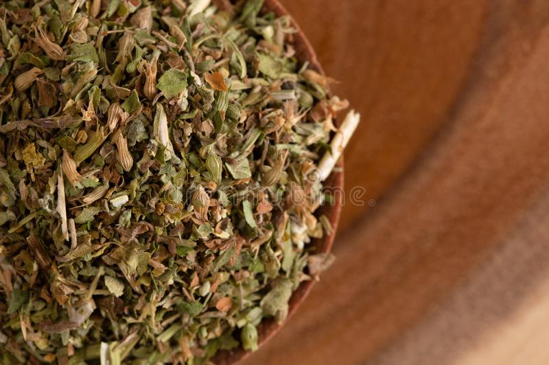 Bowl of Catnip on Wooden Table. A Bowl of Catnip on Wooden Table stock images