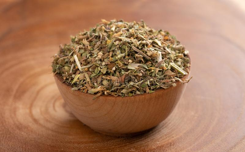 Bowl of Catnip on Wooden Table. A Bowl of Catnip on Wooden Table stock photography