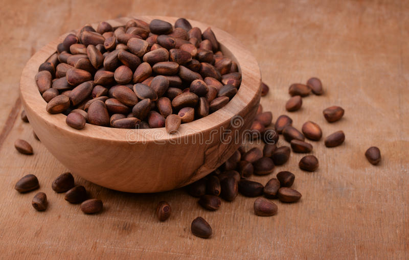 Bowl of cedar nuts royalty free stock photo