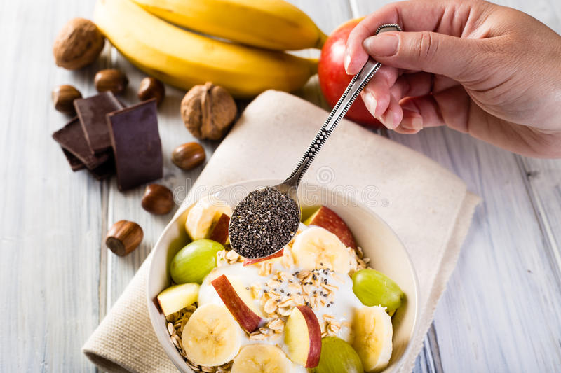 Bowl of cereal and chia seeds. Healthy breakfast. stock photos