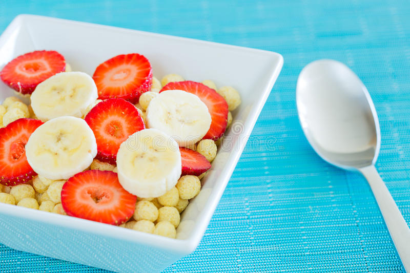 Bowl of Cereal. With Fresh Strawberries and Bananas royalty free stock photo