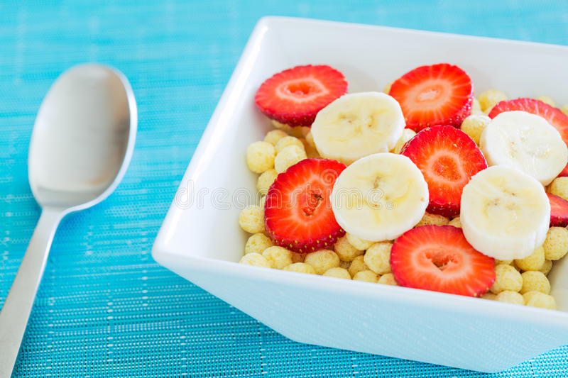 Bowl of Cereal. With Fresh Strawberries and Bananas royalty free stock photography