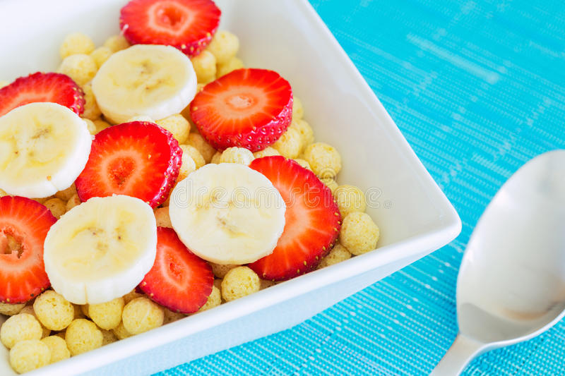 Bowl of Cereal. With Fresh Strawberries and Bananas royalty free stock images