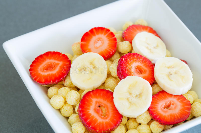 Bowl of Cereal. With Fresh Strawberries and Bananas royalty free stock photos