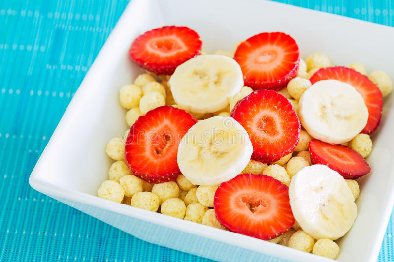 Bowl of Cereal. With Fresh Strawberries and Bananas stock photography