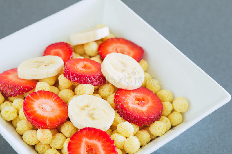 Bowl of Cereal. With Fresh Strawberries and Bananas stock image