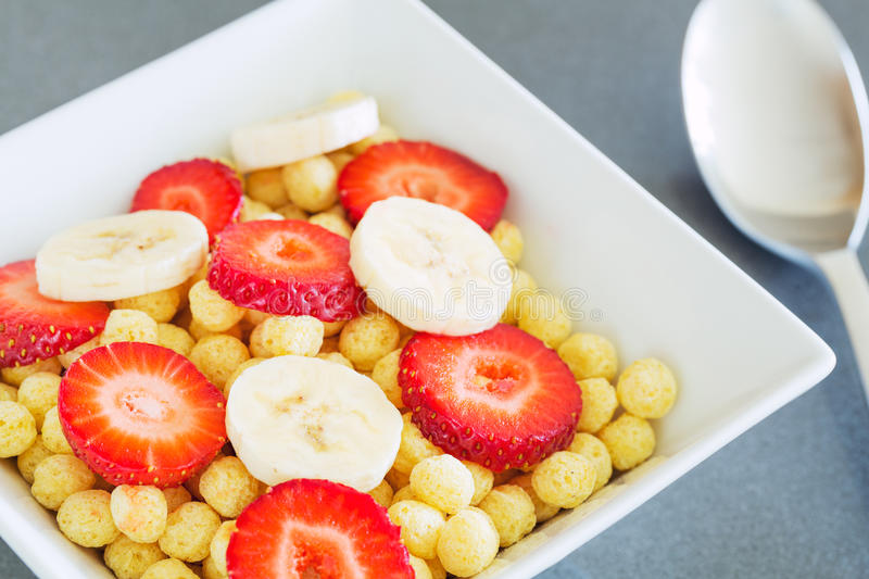 Bowl of Cereal. With Fresh Strawberries and Bananas stock photo