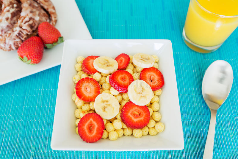 Bowl of Cereal. With Fresh Strawberries and Bananas stock photos
