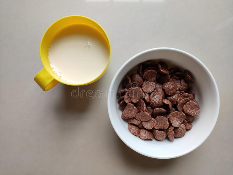 Bowl of cereal and fullcream fresh milk for breakfast royalty free stock photos