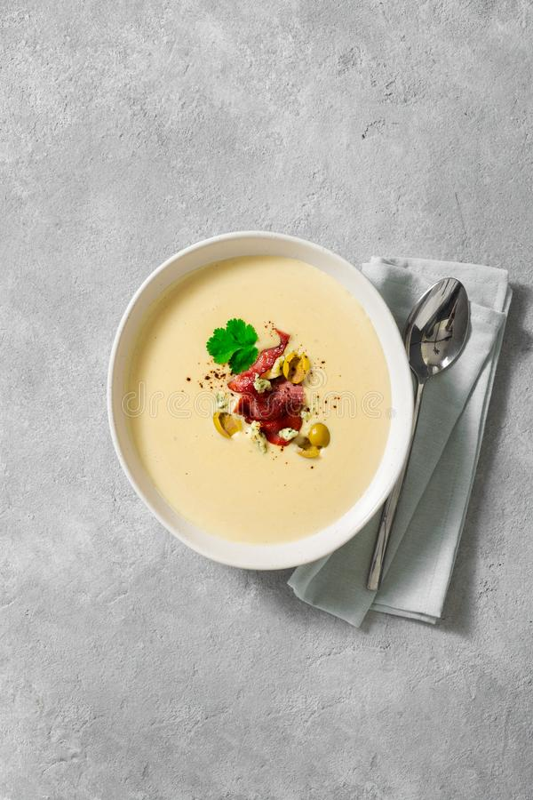Bowl cheese soup bacon olives top view. Bowl of cheese soup with bacon and olives top view stock photo
