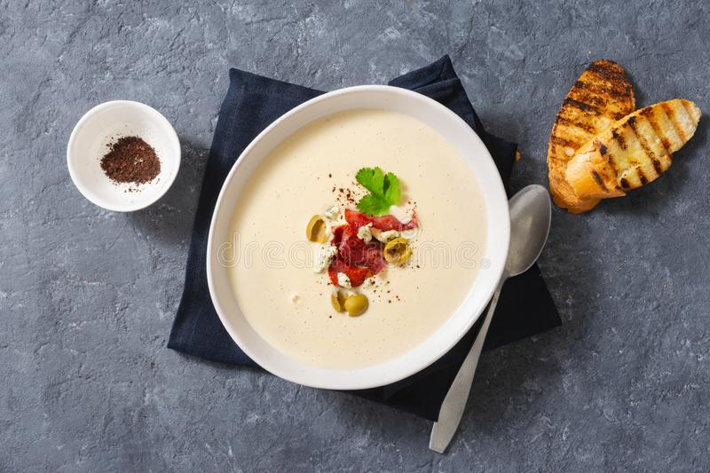 Bowl cheese soup bacon olives top view. Bowl of cheese soup with bacon and olives top view royalty free stock image
