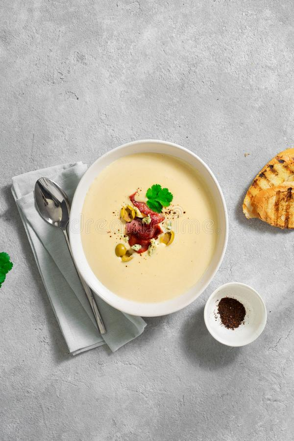 Bowl cheese soup bacon olives top view. Bowl of cheese soup with bacon and olives top view royalty free stock images