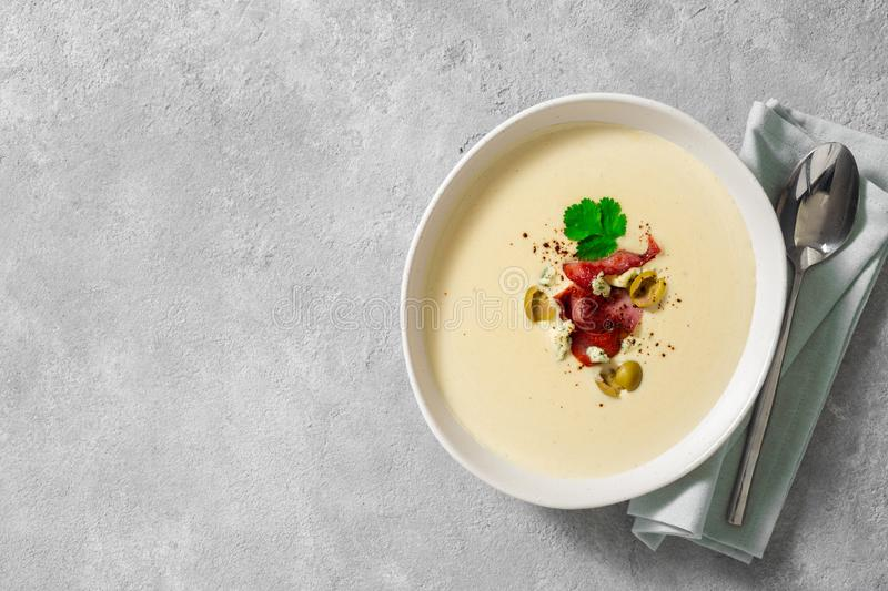 Bowl cheese soup bacon olives top view copy space. Bowl of cheese soup with bacon and olives top view copy space royalty free stock images