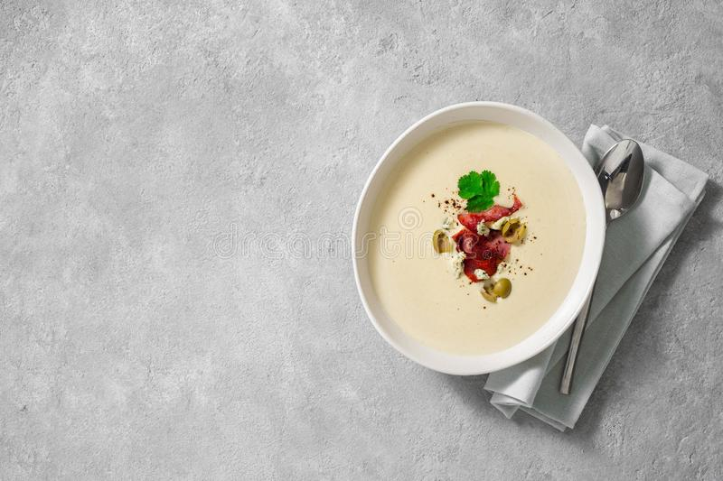 Bowl cheese soup bacon olives top view copy space. Bowl of cheese soup with bacon and olives top view copy space stock image