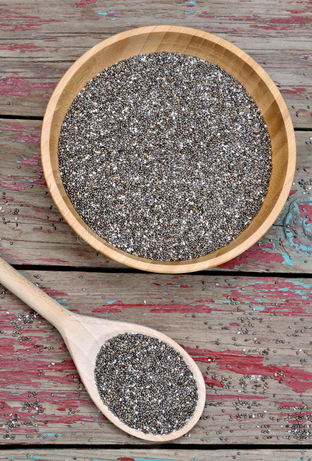 Bowl with chia seeds. On rustic wooden table stock photo