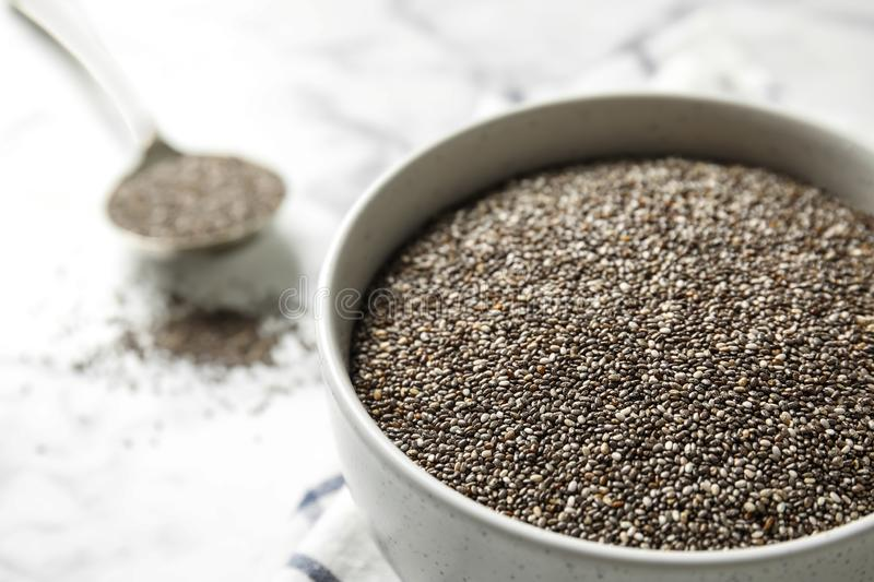 Bowl with chia seeds on table, closeup. Space for text stock image