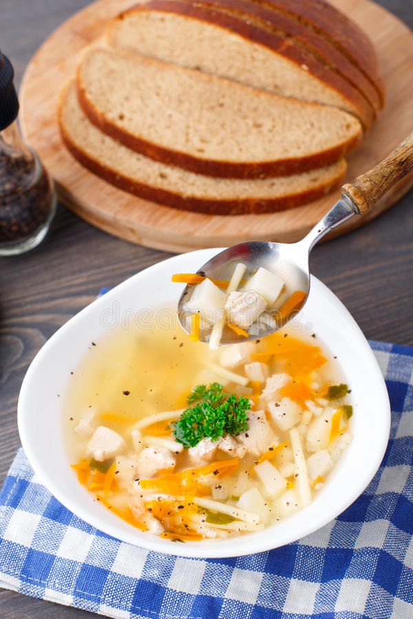 Download Bowl Of Chicken Soup With Vegetables And Noodles Stock Image - Image: 33926235