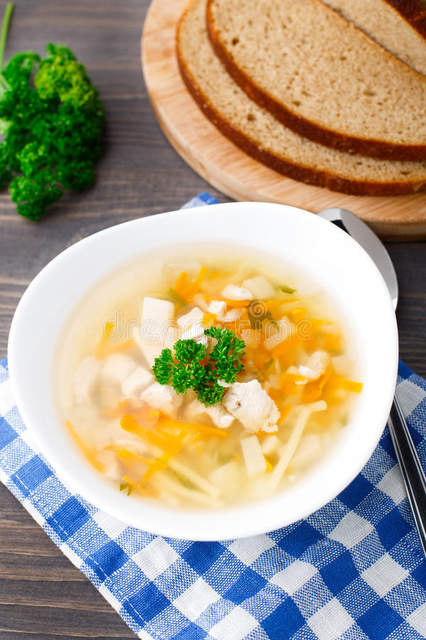 Download Bowl Of Chicken Soup With Vegetables And Noodles Stock Image - Image: 33926291