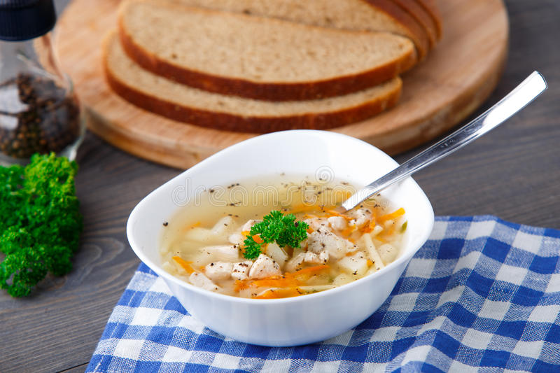 Download Bowl Of Chicken Soup With Vegetables And Noodles Stock Photo - Image: 33926320