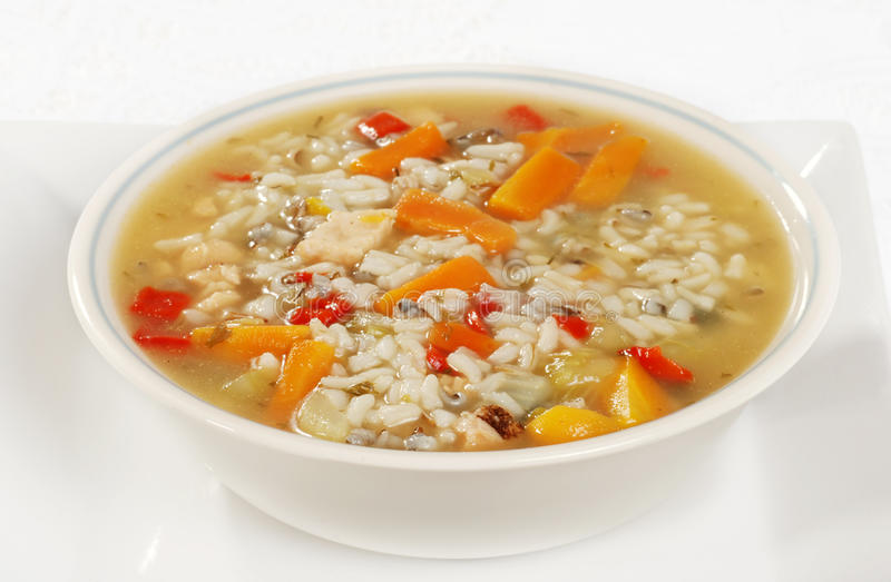 Bowl of chicken and wild rice soup with vegetables stock photos
