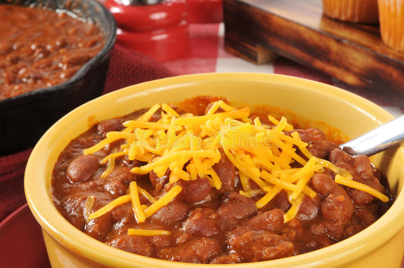 Bowl of chili with cheddar cheese stock photos