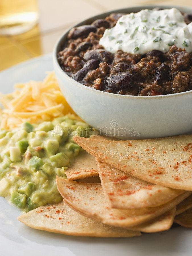 Bowl of Chilli with Tortilla Chips stock photography