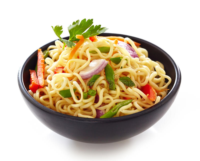 Bowl of chinese noodles with vegetables royalty free stock photos