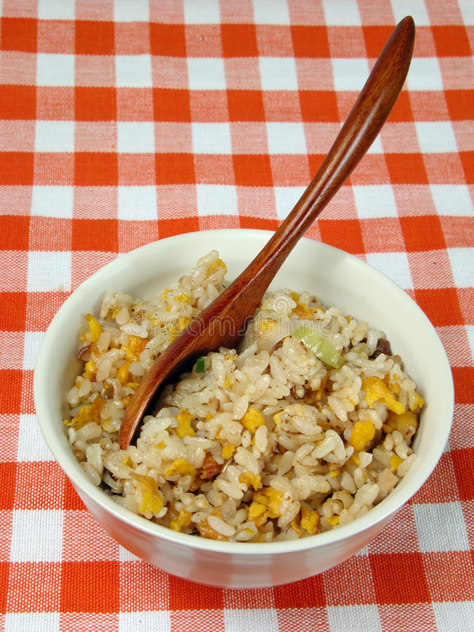 Bowl with Chinese rice on a table stock photo