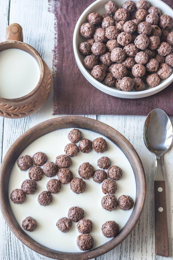 Bowl of chocolate corn balls stock photography