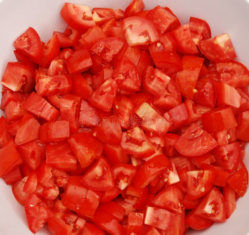 Bowl Of Chopped Tomatoes. A bowl full of freshly chopped juicy tomatoes stock photos