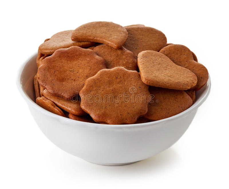 Bowl of christmas cookies isolated on white royalty free stock photo